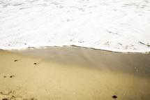 sea foam on sand
