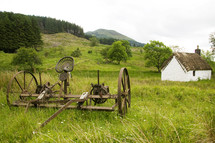 antique horse draw plow in a field