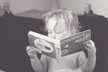 toddler reading Goodnight moon book
