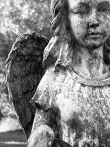 Guardian Angel Female Figure in black and white photograph weathered by time, harsh weather and years of exposure to the elements stands firm reminding us that there is a life outside of this one called Eternity where we can go to be with Jesus and our loved ones who have passed on before us