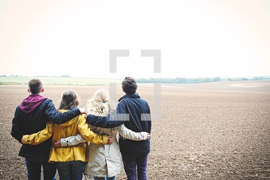 teens standing together in a field