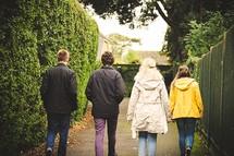 teens walking down a sidewalk together