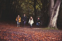 teens walking together outdoors on a fall day