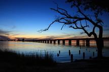 bridge across a river at dusk