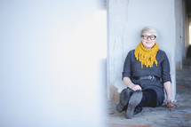 a woman with a pixie hair cut sitting