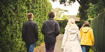 teens walking together outdoors in fall