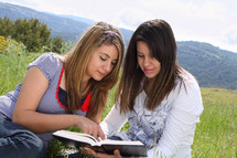 teen girls reading together