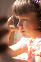 girl child talking on the phone