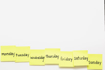 Days of the week written on yellow sticky notes.