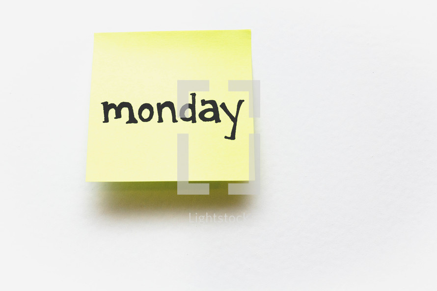 """""""Monday,"""" written in black ink on a yellow sticky note."""