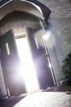 glow of sunlight pouring through an open door