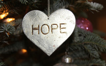 hope heart ornament hanging on a Christmas tree