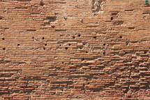 Weathered brick wall.