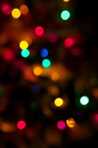 Colored Christmas lights at night.