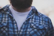 A man with a beard wearing a blue shirt