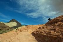 man climbing a rock in Nevada