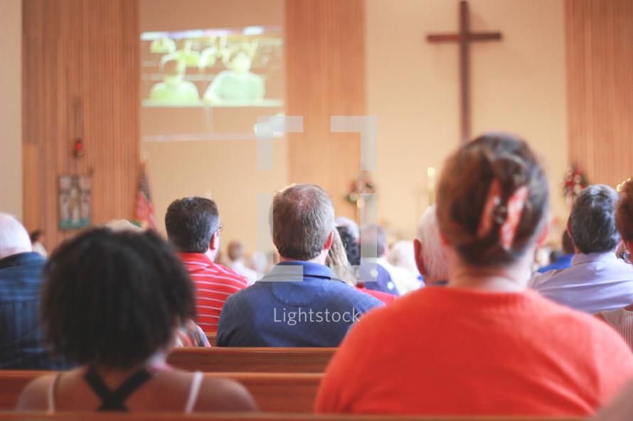 parishioners sitting in church pews at a Lutheran church