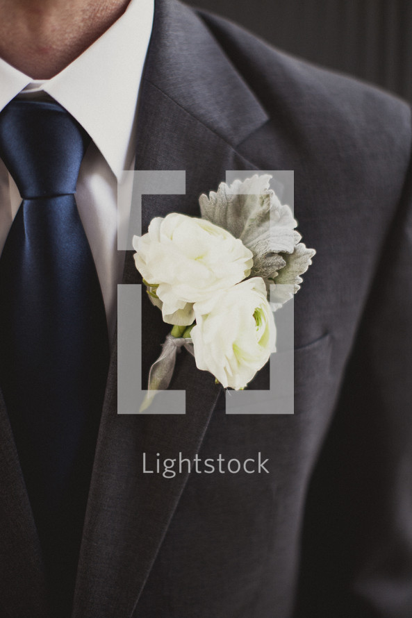 A close-up of a man's boutonniere