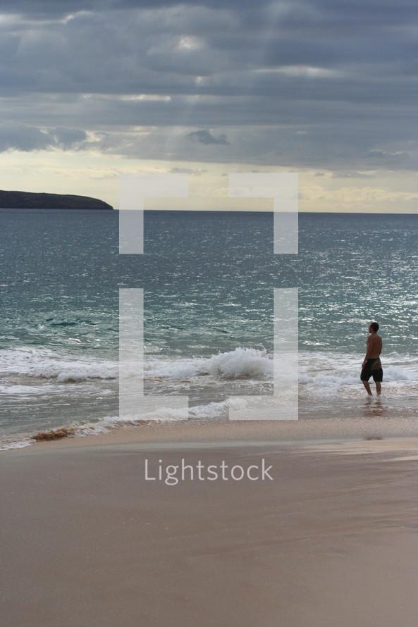Man wading in ocean