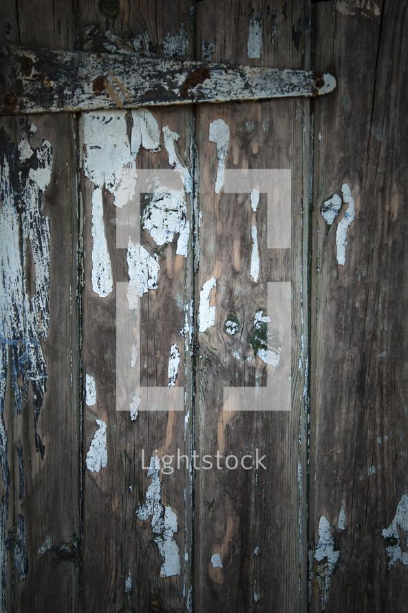 Old wooden door and henge