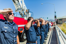 fire fighters men in salute honor respect first responders hero