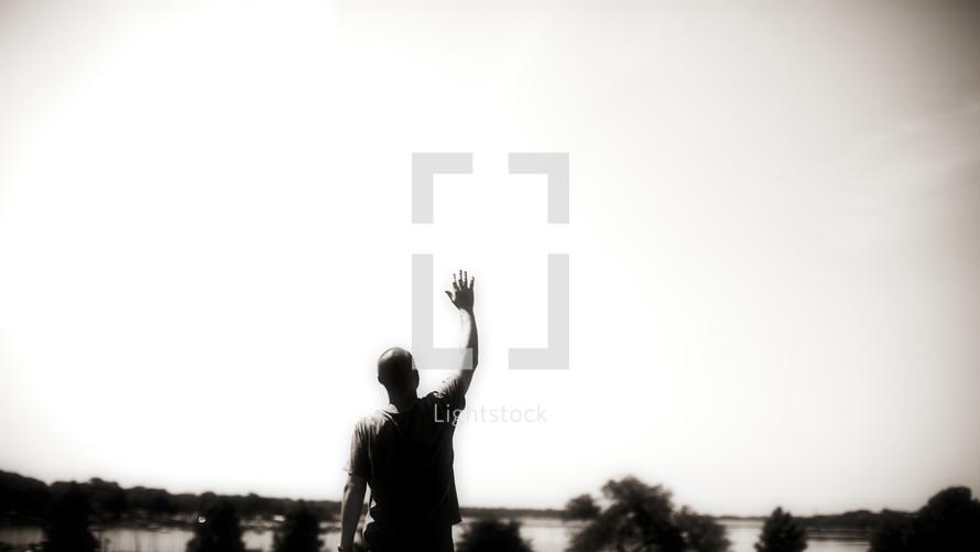 man with hand raised