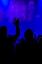 Worship service hands raised blue silhouette