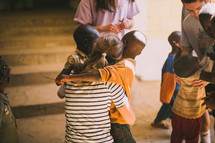 missionary hugging a child in Africa