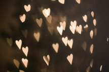 heart shaped bokeh white lights on a Christmas tree
