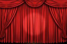 Spotlight on stage curtains.