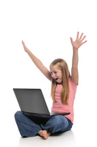 girl child on a laptop with raised hands