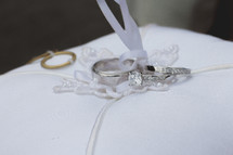 wedding rings on a ring bearer pillow