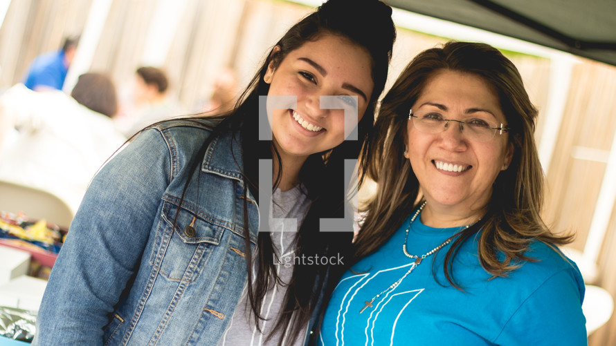 mother and daughter standing together at a church reception