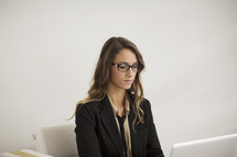 a woman sitting behind a desk
