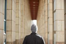 a man standing in a corridor