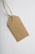 A blank, brown paper gift tag.