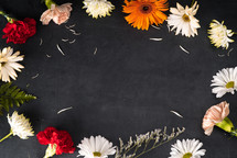 border of flowers on black