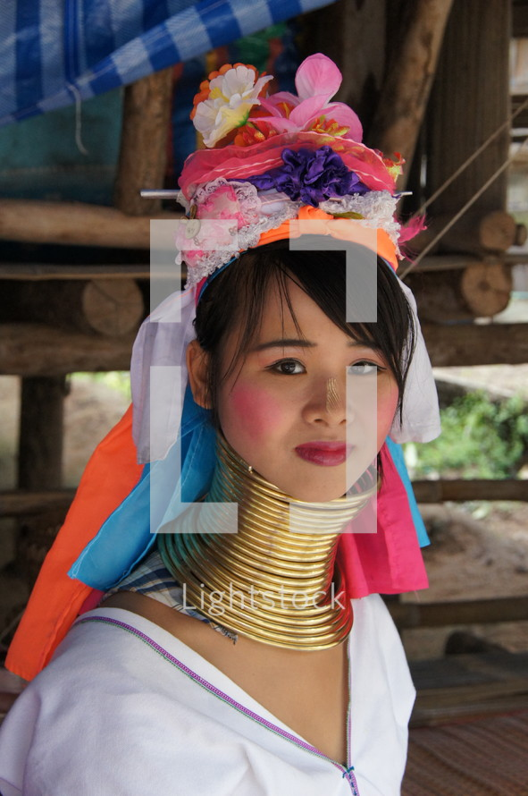 An Asian woman in traditional clothing.