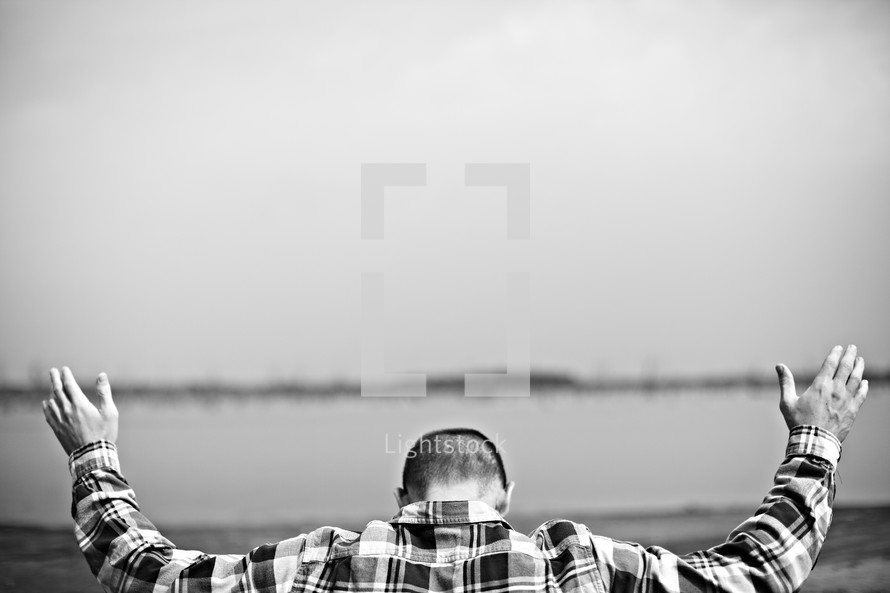 White man worshipping with his hands raised
