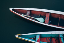 paddles in a boat on the Amazon River