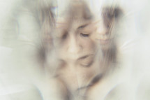 Image of a woman, taken through a crystal