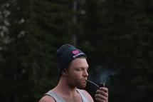 a man smoking a pipe