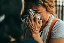 elderly woman crying