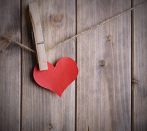 red paper heart on clothespin