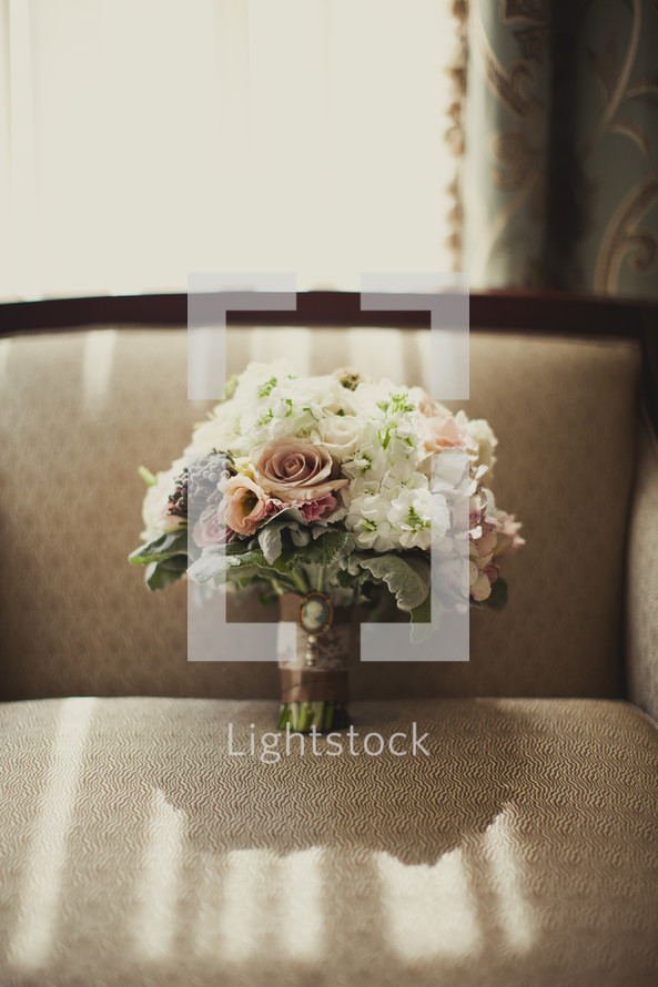 bouquet of roses resting on a couch