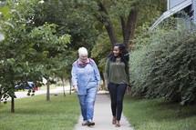 women walking together on a sidewalk