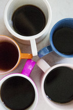 colorful coffee mugs in a circle