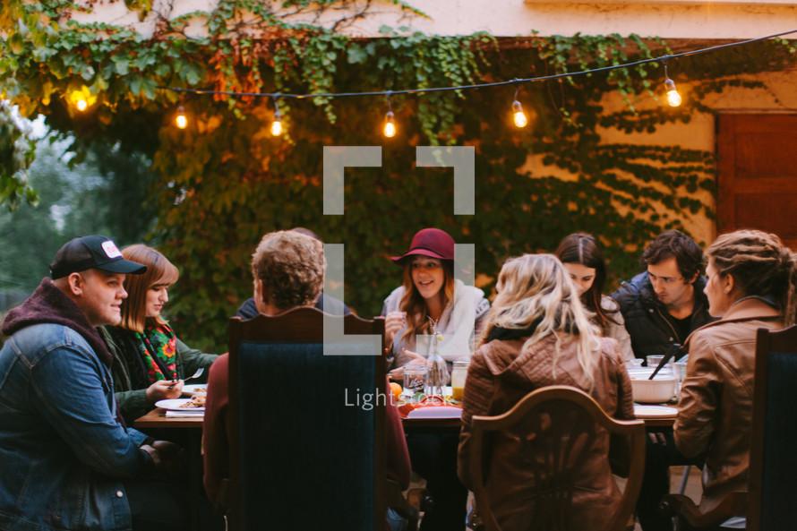 Friends Having an Outdoor Dinner During Autumn