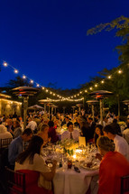 Outdoor reception dinner party event, lights night heaters