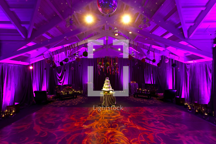 A wedding reception room dancing cake celebration event lighting